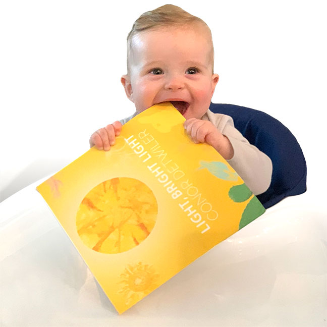 Happy child holding Light, Bright Light, a meditation picture book